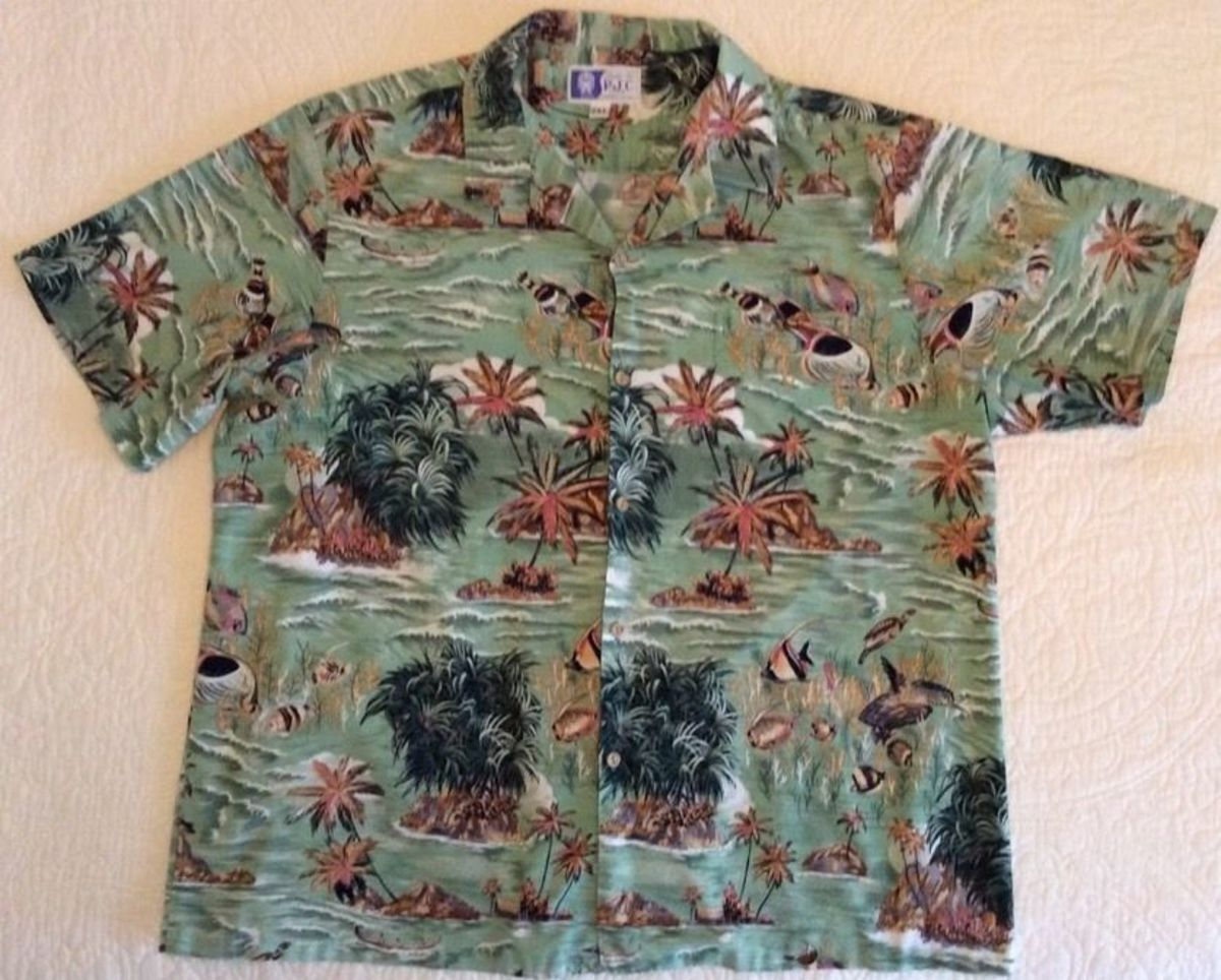 A RJC Mens Hawaiian Aloha Shirt. Made in Hawaii. This beautiful Shirts features Tropical Fish, Boats in colors of light green dark green, tan, brown and white. Front left pocket., and it is 100% Cotton.