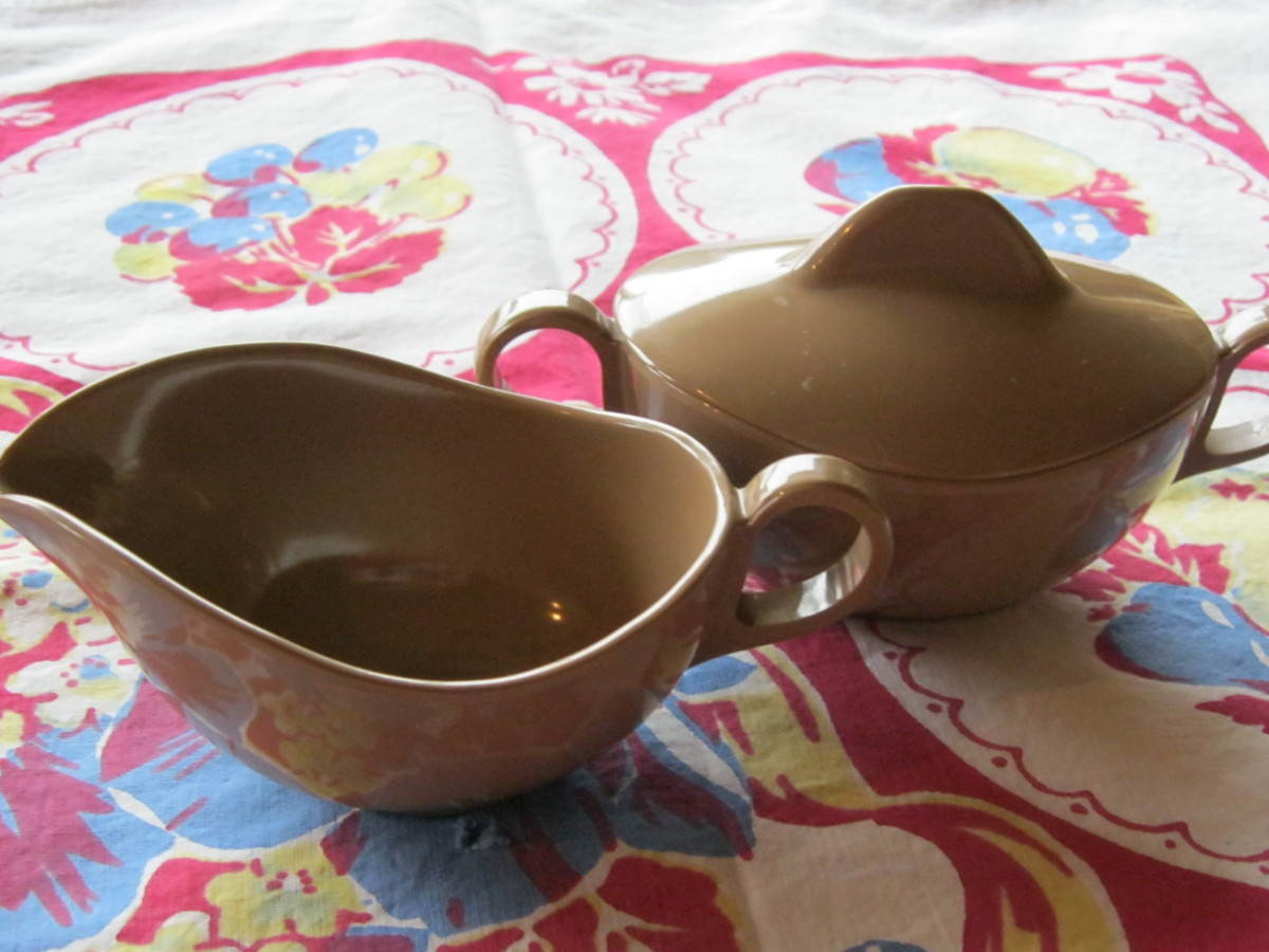 Unmarked later Melamine sugar and creamer.  Modern style in medium tan, lighter weight than earlier pieces.