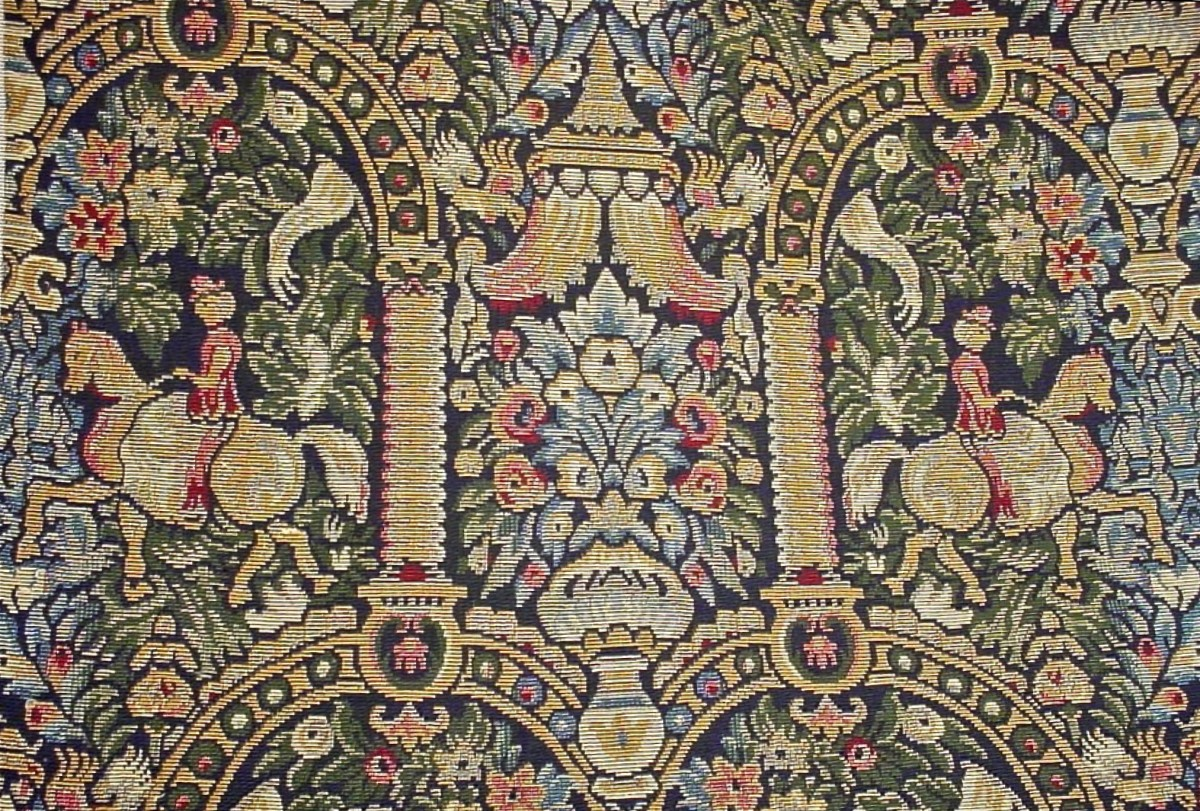 A reproduction of a medieval design woven into upholstery fabric on a Jacquard Loom. Copyright 2014 Restoration Fabrics & Trims. All Rights Reserved. Used with Permission.