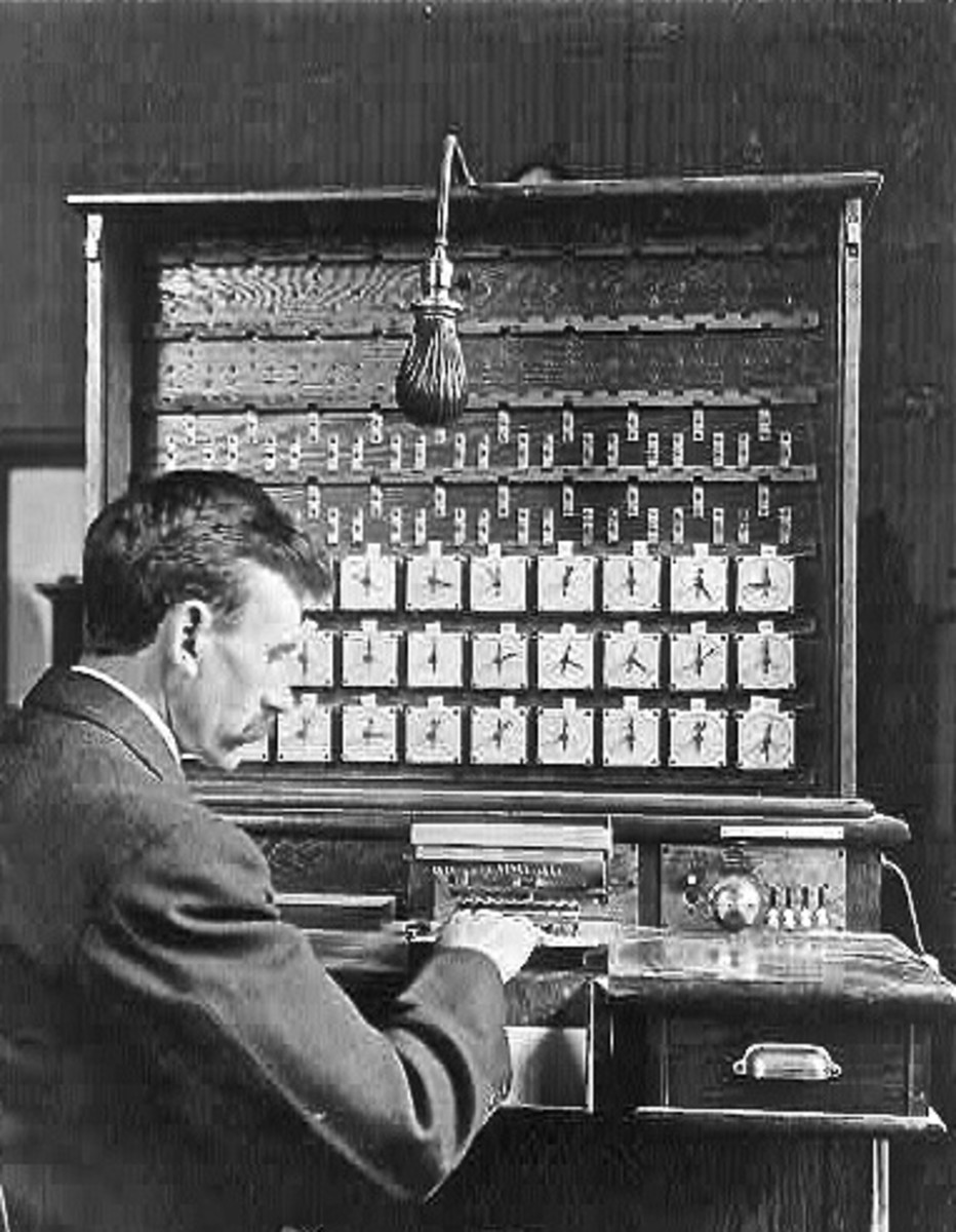 Herman Hollerith demonstrates his tabulating machine in this 1908 photo