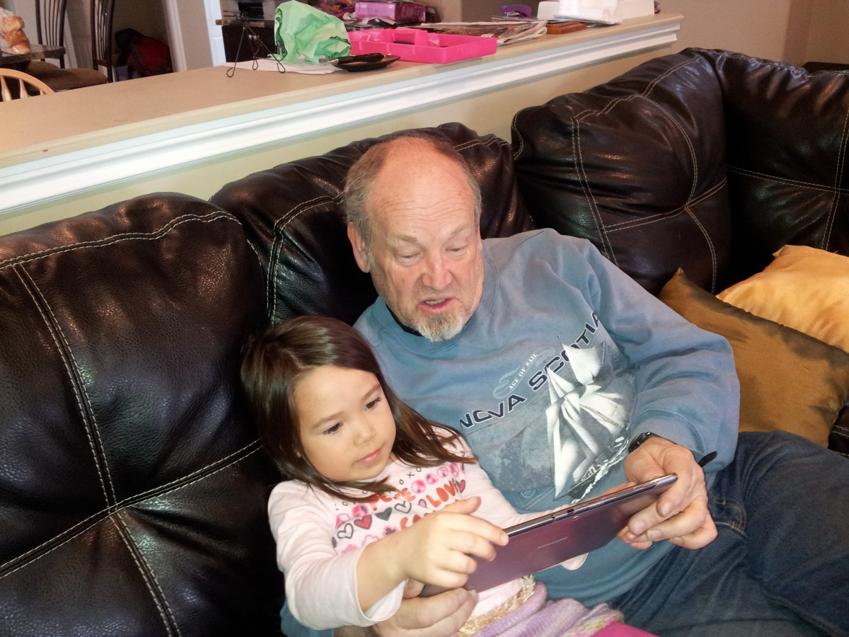 The New Grandpa reads from a tablet?
