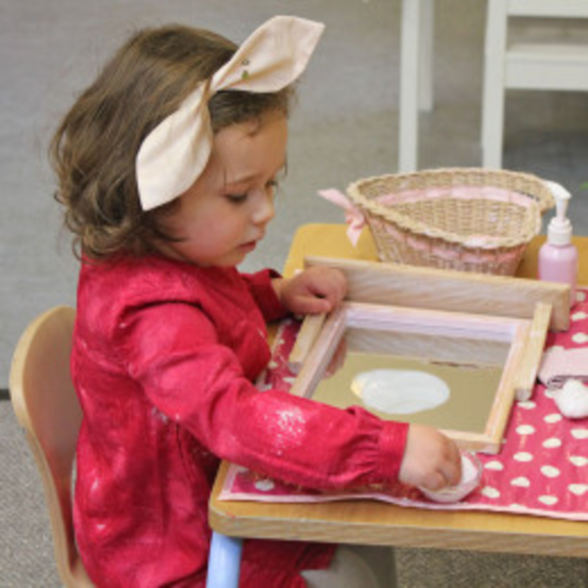 Young child working independently and individually.