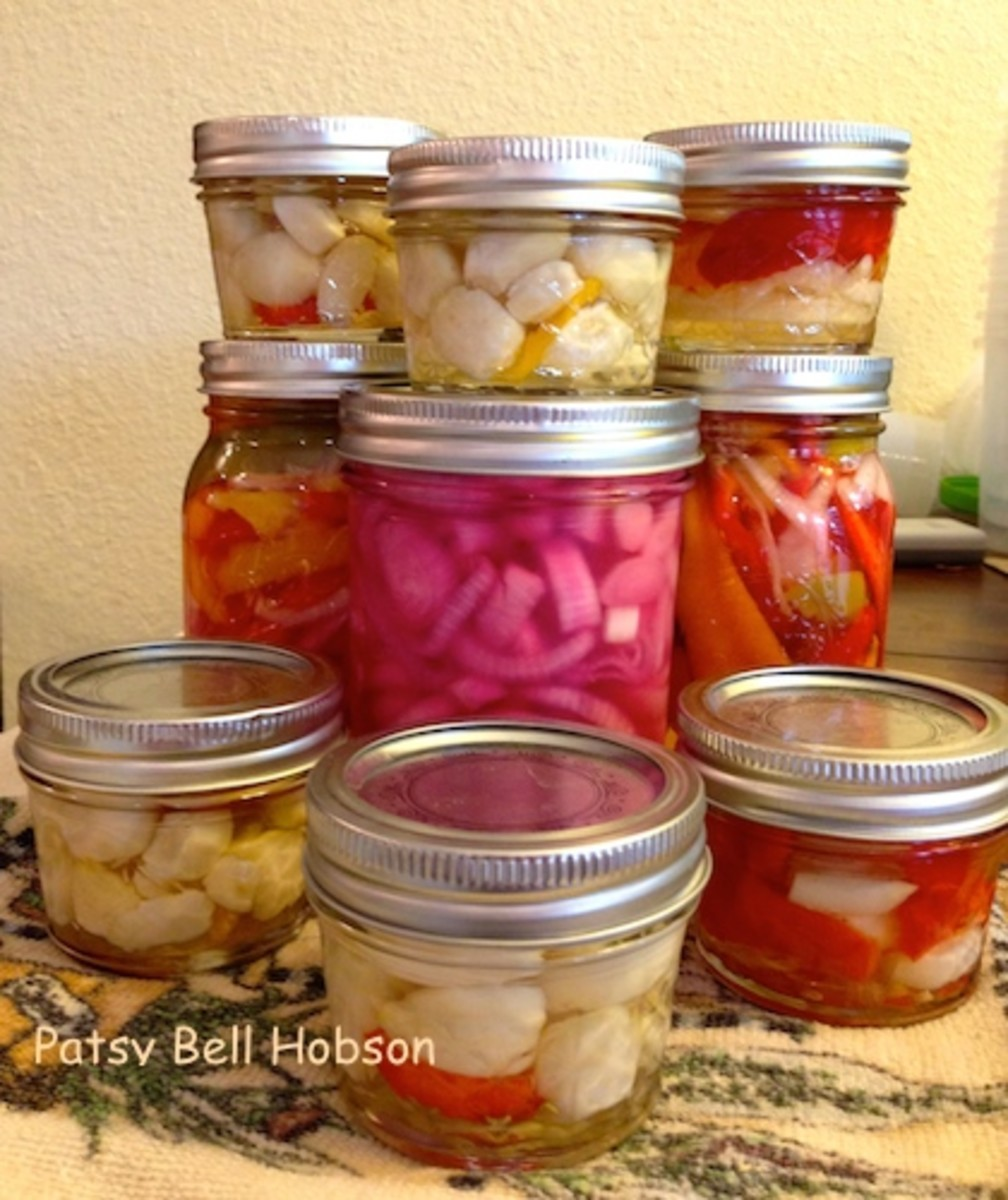 Store garlic in small jars to share. Pickled onions (in the center) are made by using small to medium red onions.