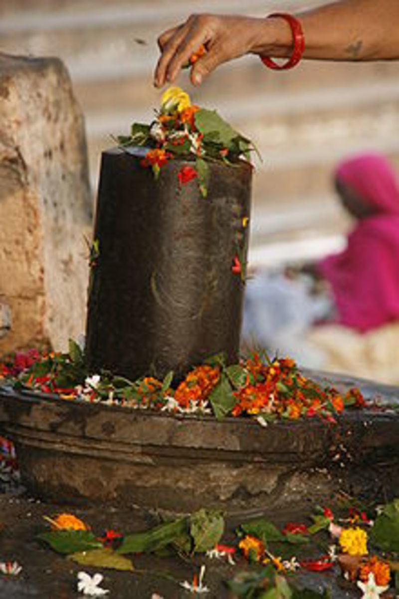 Traditional flower offering to a Shiva Lingam.   Linga is a symbol of Lord Siva.