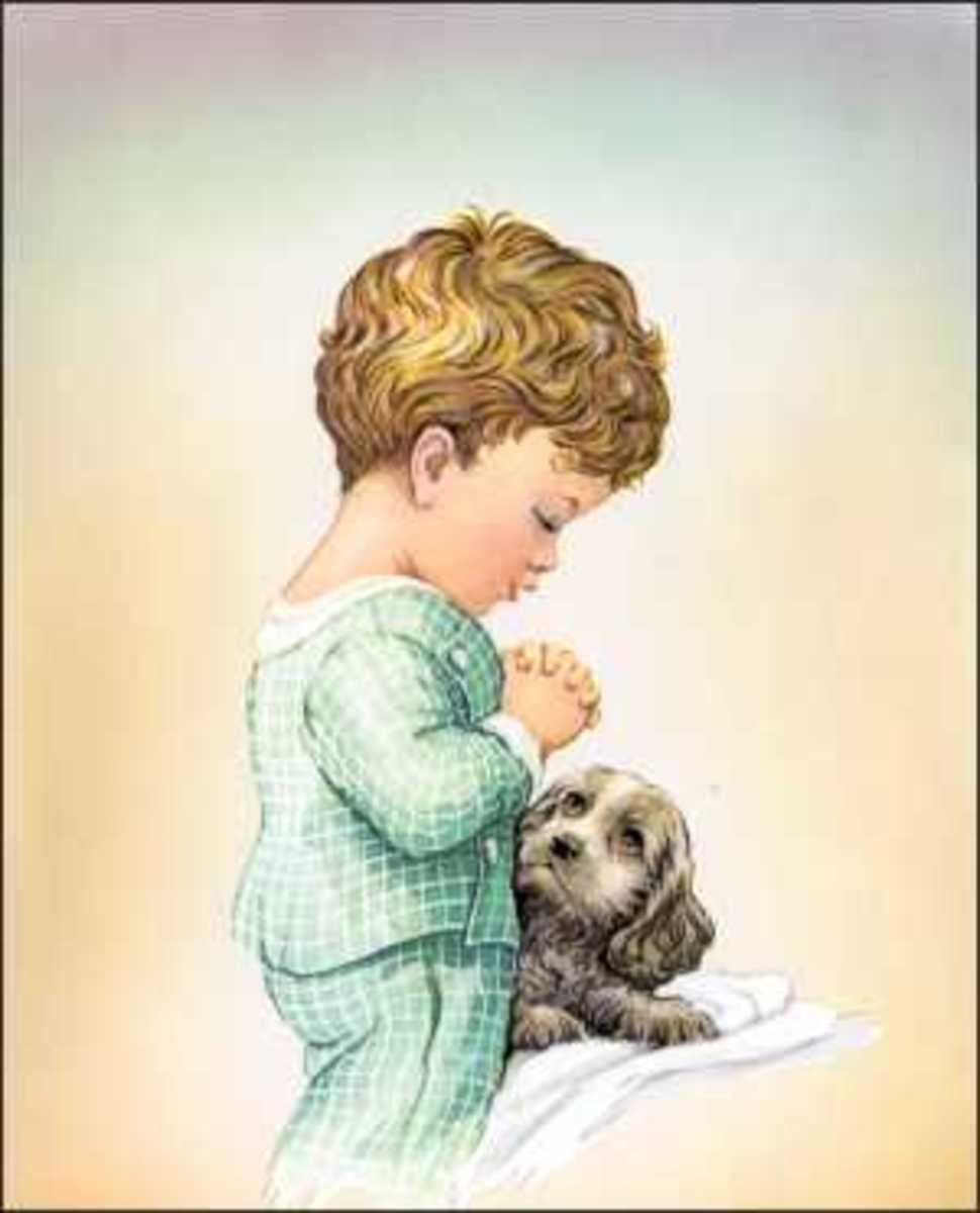 Little Boy kneeling to pray