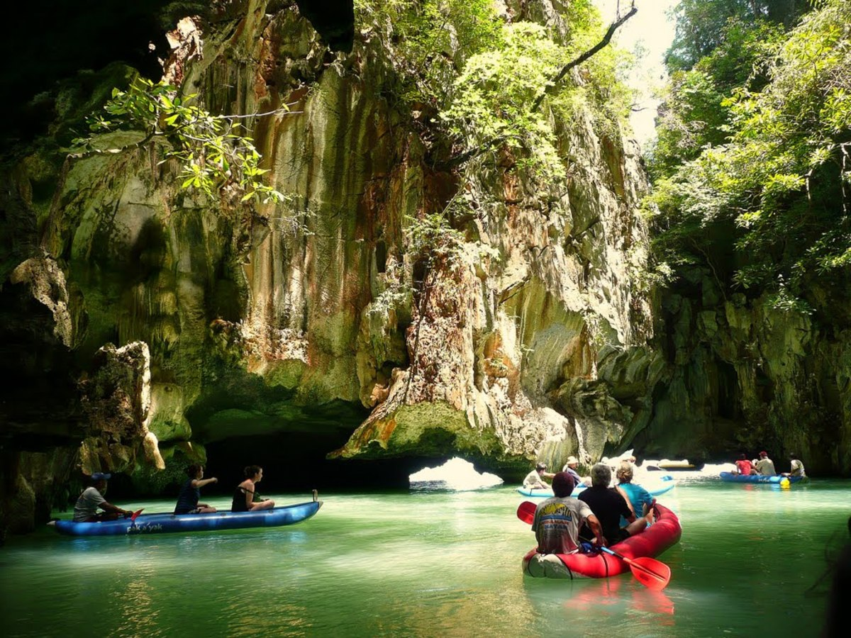 Explore the many caves and lagoons at Phang Nga Bay in Phuket by canoe.