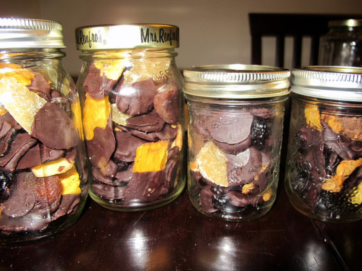 Chocolate covered dried fruits in a jar