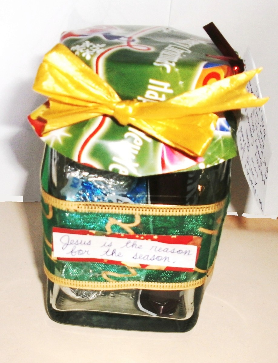 Jar decorated with wrapping paper and ribbons