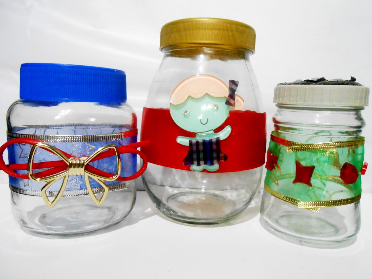 Recycled jars with ribbons and embellishments