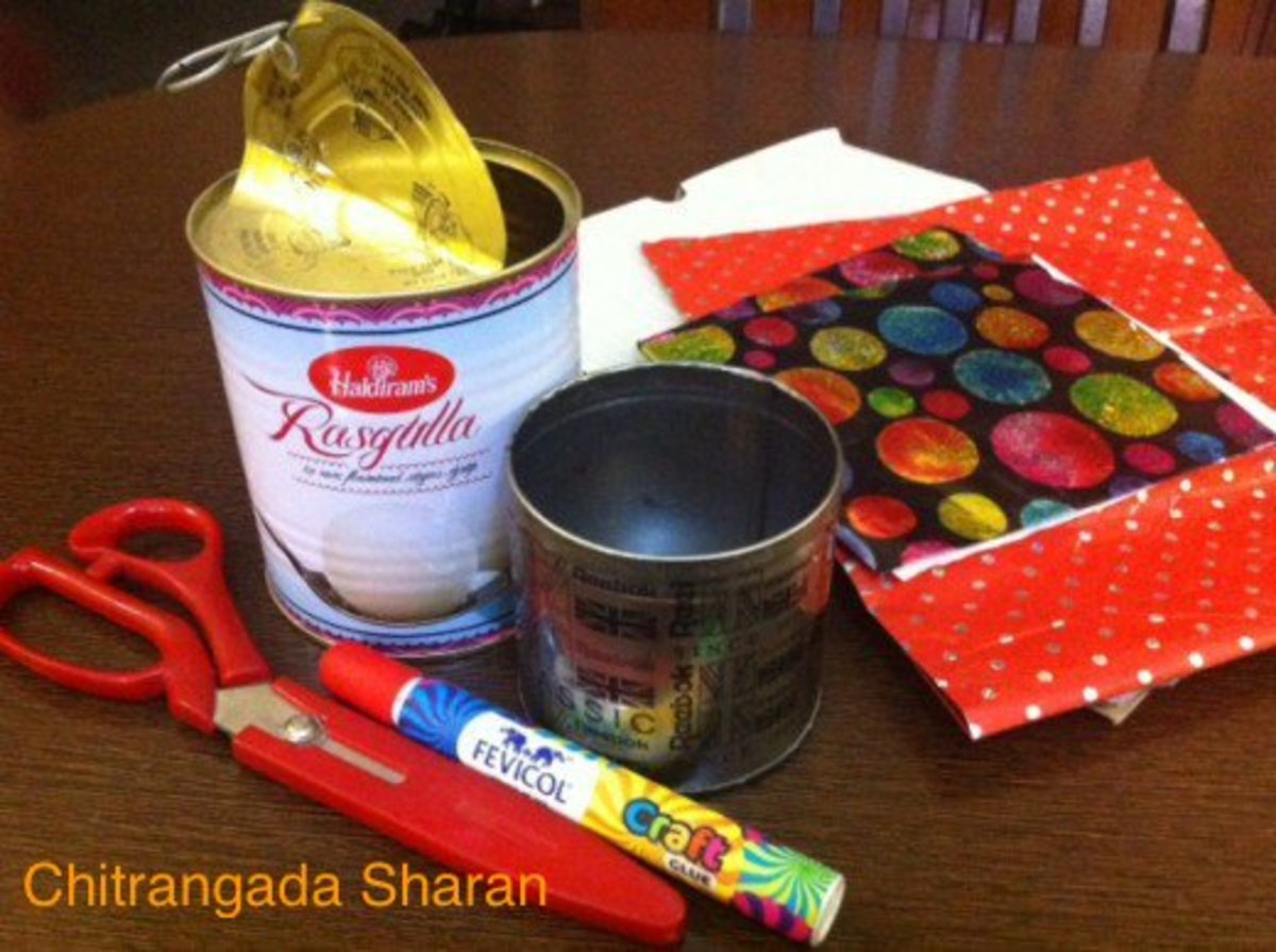 Used metal containers , used gift wrapping papers, scissors, glue/ Fevicol, used packing cardboard