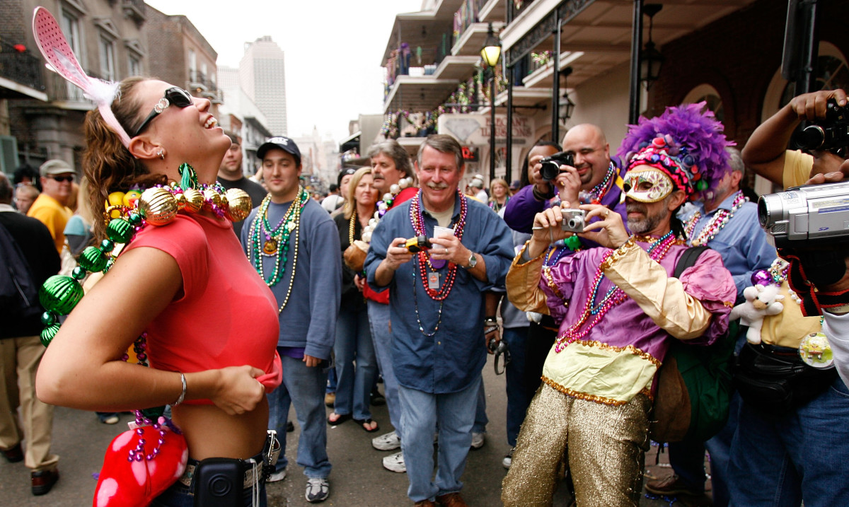 Learn more about the origins of flashing to earn beads at Mardi Gras, courtesy of PBS.