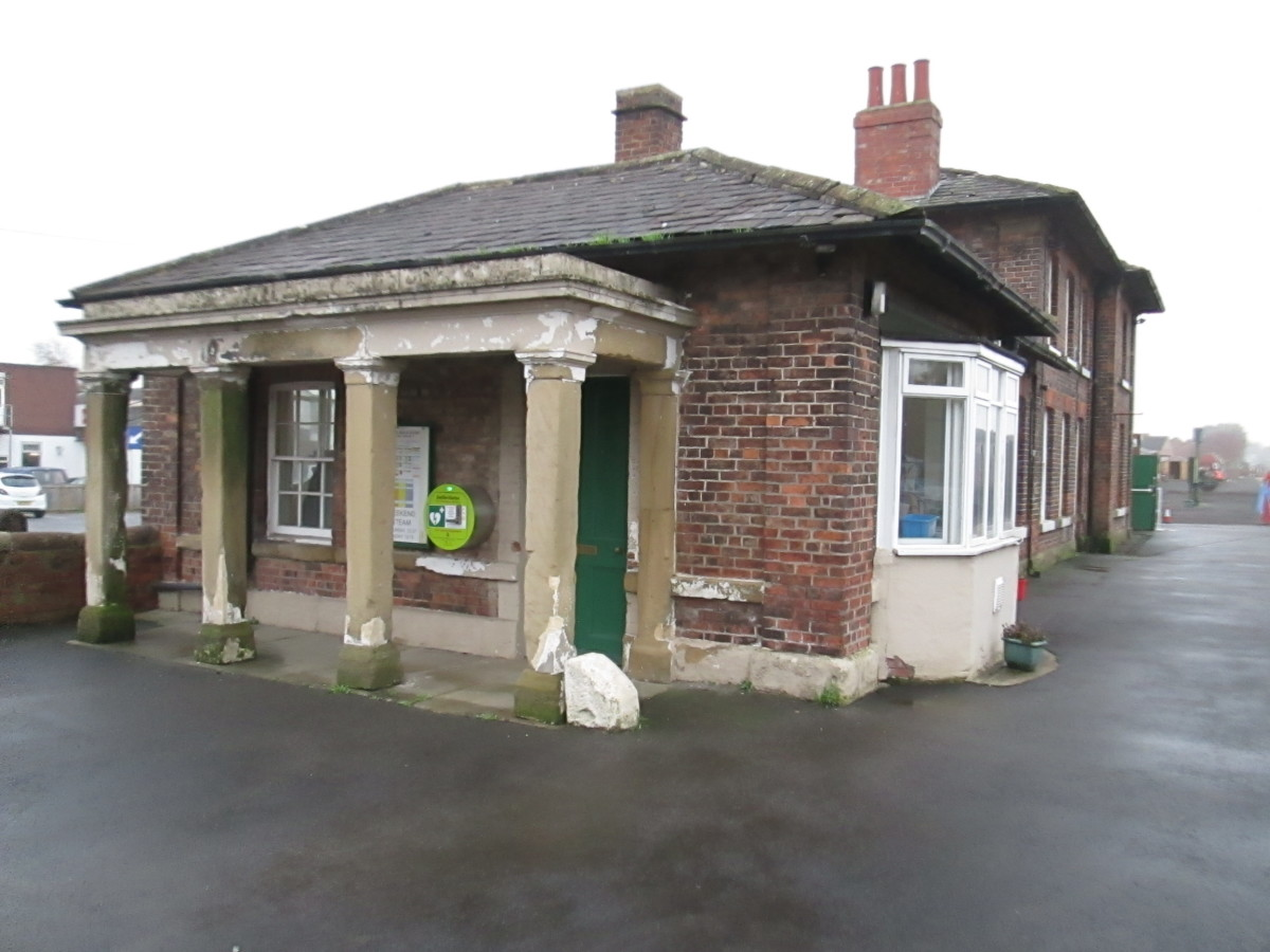 Leeming Bar Station buildings on the Wensleydale Railway with the handsome portico that faces onto the road north away from the roundabout.