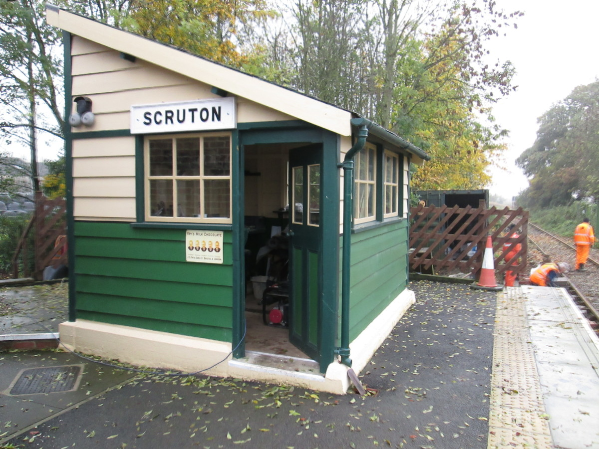 Platform signal cabin at Scruton Station prior to platform extension in 2016, on the Wensleydale Railway between Northallerton and Leeming Bar - cabin controlled signals within its block section, pointwork into a compact goods yard & coal depot