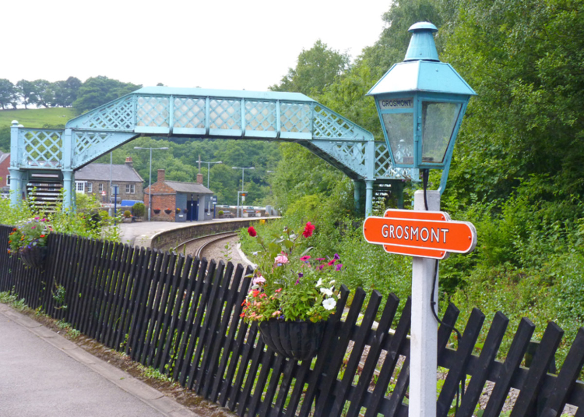 Grosmont, junction with Northern Rail branch to Whitby and North Yorkshire Moors Railway. Note detail touches, gas lamps with enamel name lozenge, footbridge, diagonally arranged platform fencing, brick open shelter on adjacent platform (distance)