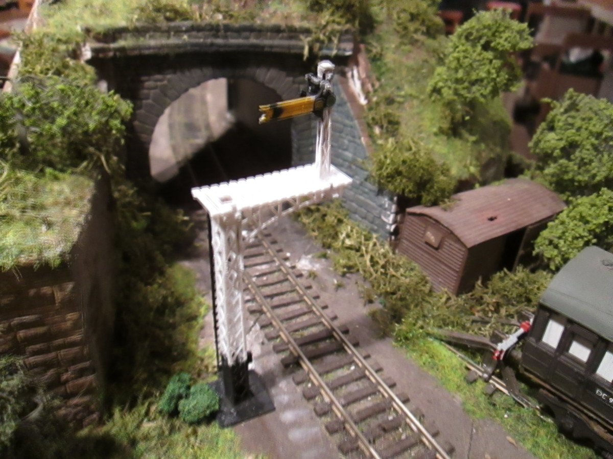 The tunnel mouth exit at Ayton Lane mpd with the  bracketed distant 'on' (Ratio kit). Van body with weathered and 'rust perforated' corrugated (aluminium) roof; scatter, lichen and trees. Track to be ash/cinder ballasted