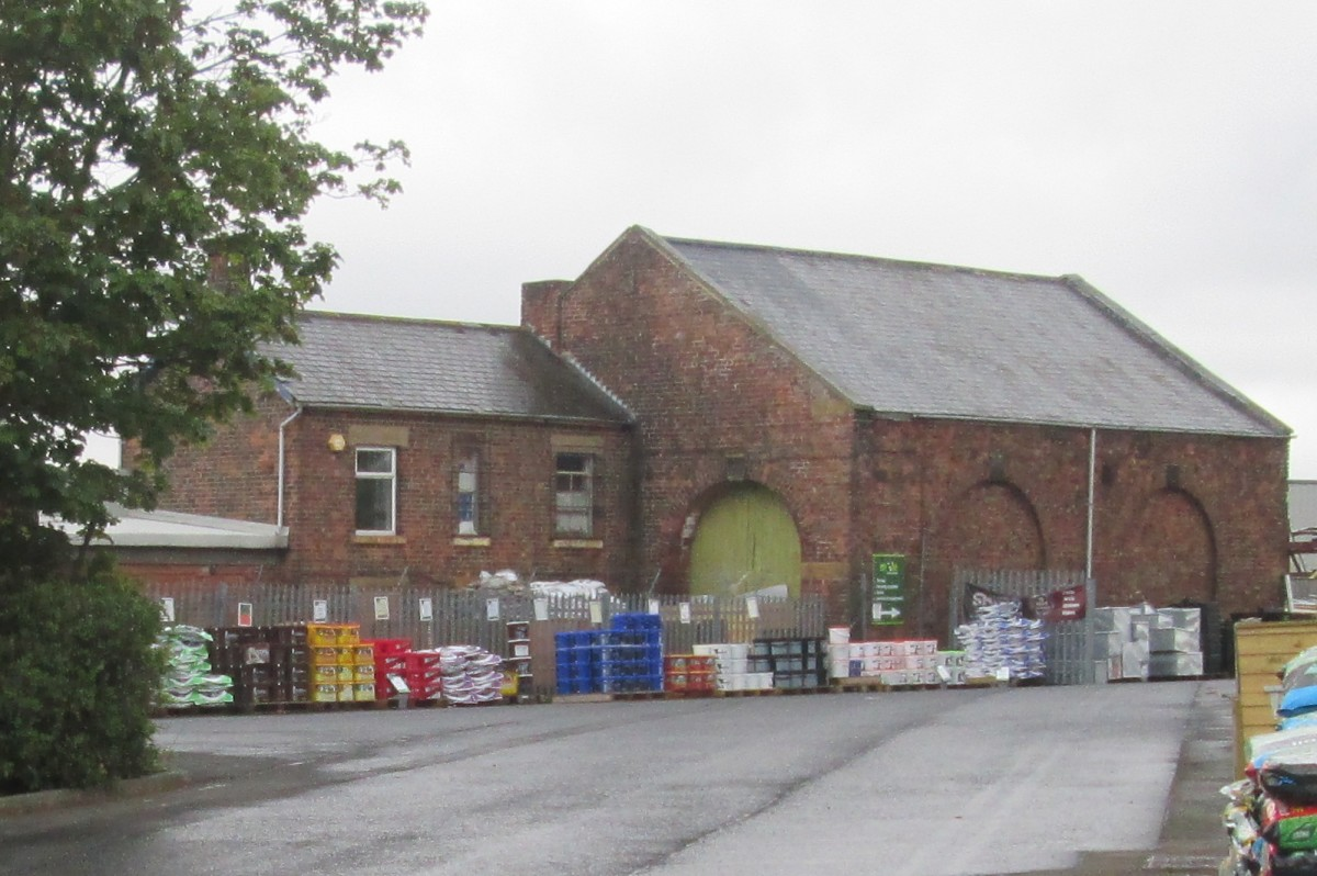 The goods shed and yard now stores building materials etc. The arch at this end was where wagons were shunted through or out. Access for carts, later lorries, was on the far side.