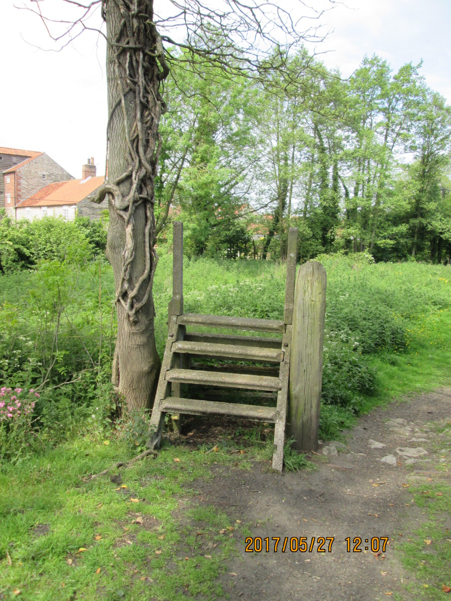 South of Pickering along the course of the railway to Rillington Jct. near Malton, is this concrete stile. Its counterpart across the track hasn't fared as well, only consists of the 'A' frames (steps gone). A handy scenic item for your railway