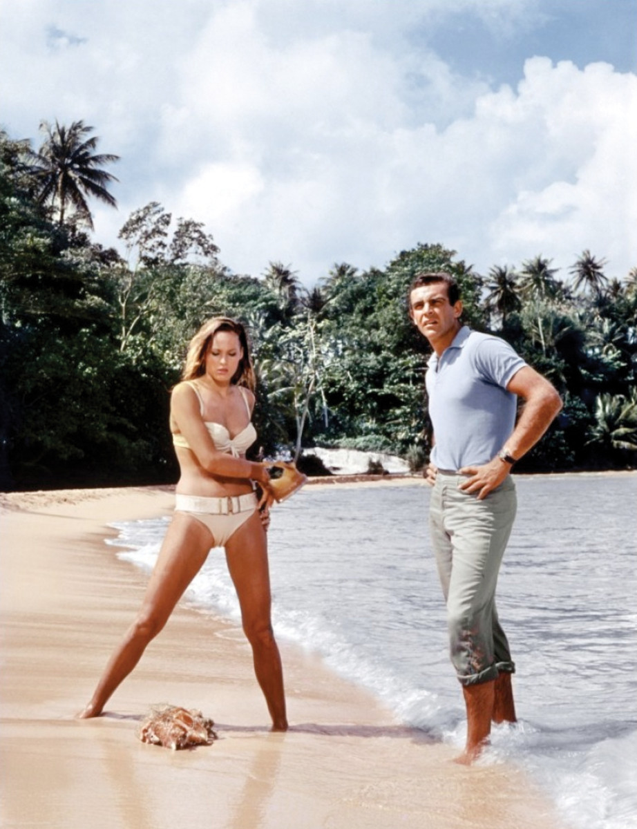 "Ursula Andress as  ""Honey Ryder"" on the beach with Sean Connery in ""Dr. No""."