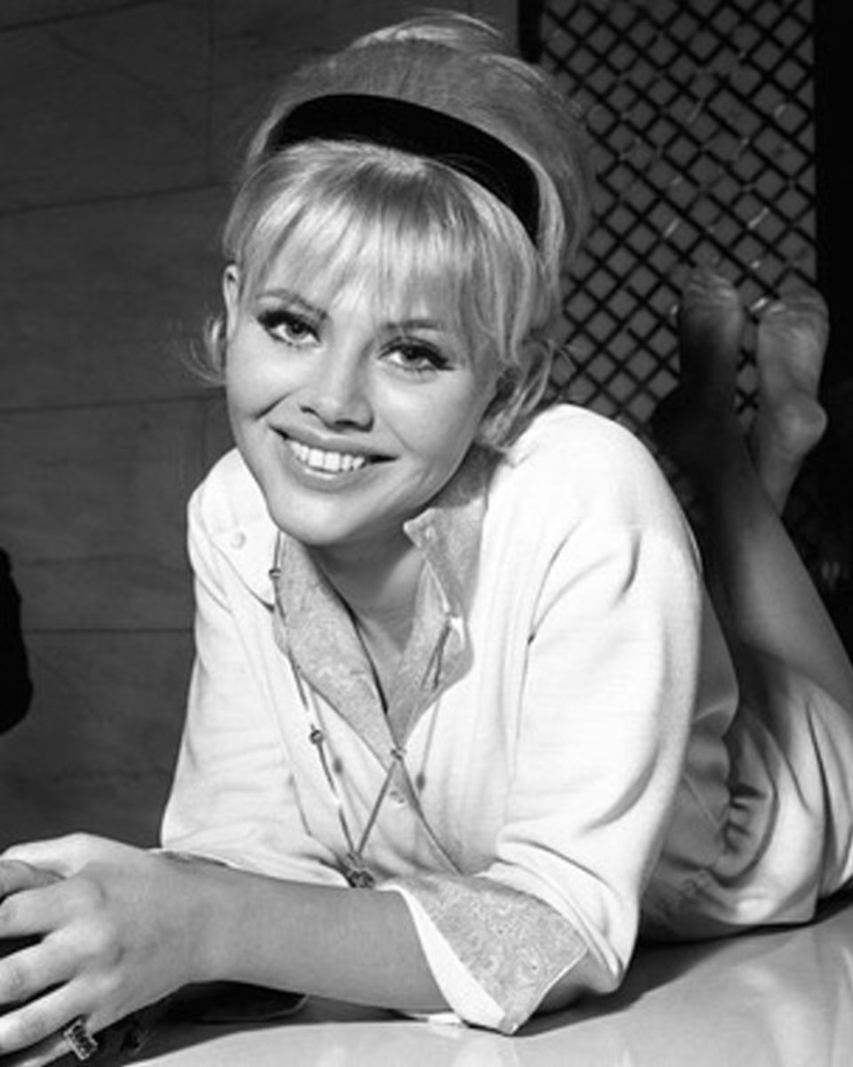 one of Britt Ekland's greatest Smiles captured in black and white picture with feet crossed.