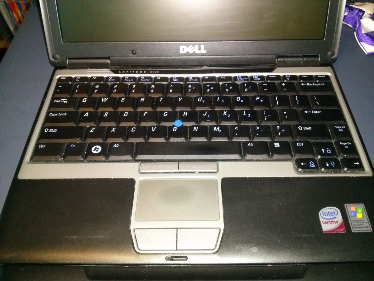 The Dell Latitude D430 after being wiped down with Clorox wipes on the palm rest, track pad and keyboard.  The track pad still has some leftover finger oils on it that a Mr. Clean Magic Eraser can clean up pretty well.