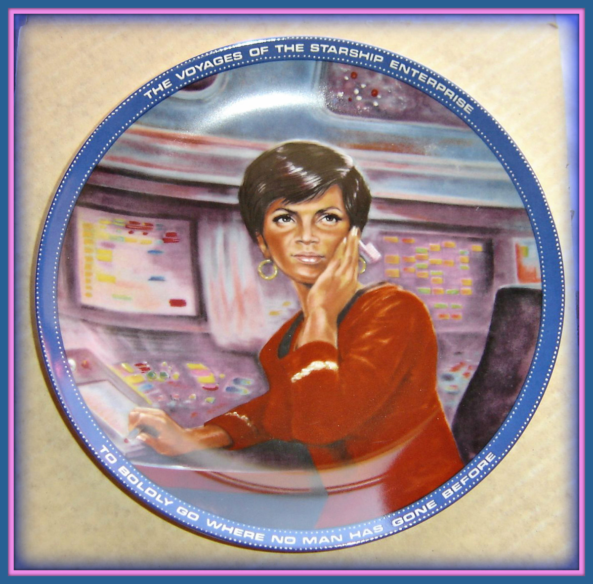 """Uhura"" is the fifth issue in a series of eight plates produced as a tribute to the crew of the Starship Enterprise. The artwork for this plate was created by celebrity artist Susie Morton on Star Date 1084.10. ""Uhura"""