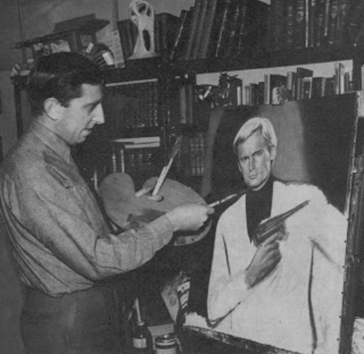 Artist Ron Embleton painting the 'Ilya'