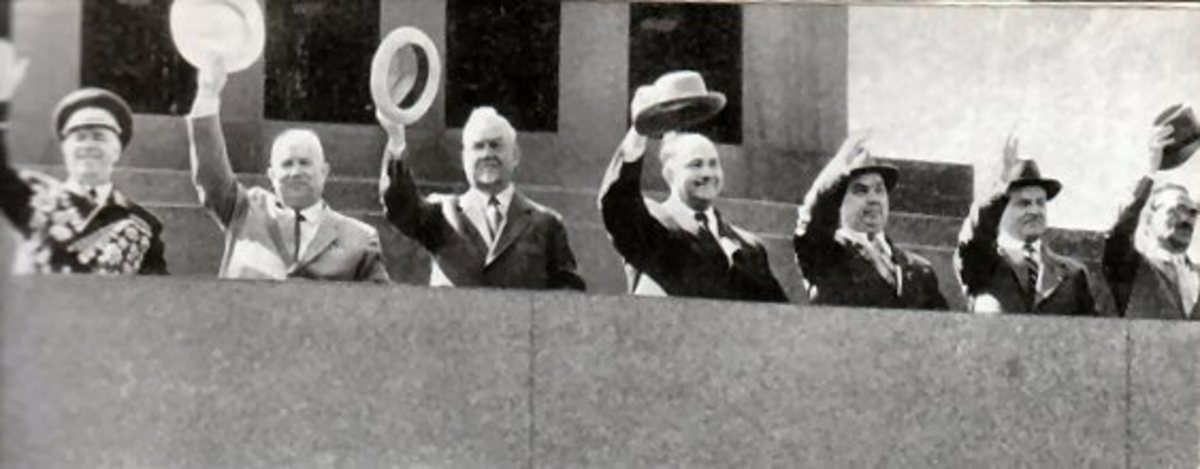 Traditional Soviet hat waving on May Day on top of Lenin's Tomb on May 1; 1957.