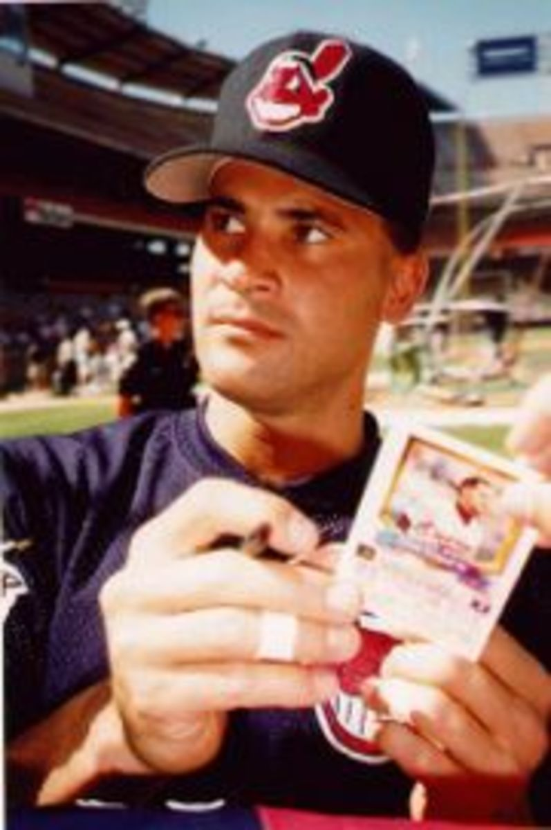 Former Cleveland Indians player Omar Vizquel wearing a baseball cap showing the image of the Cleveland Indians mascot, Chief Wahoo