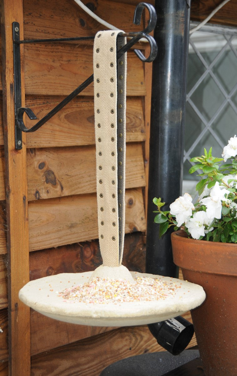 The completed hanging bird feeder