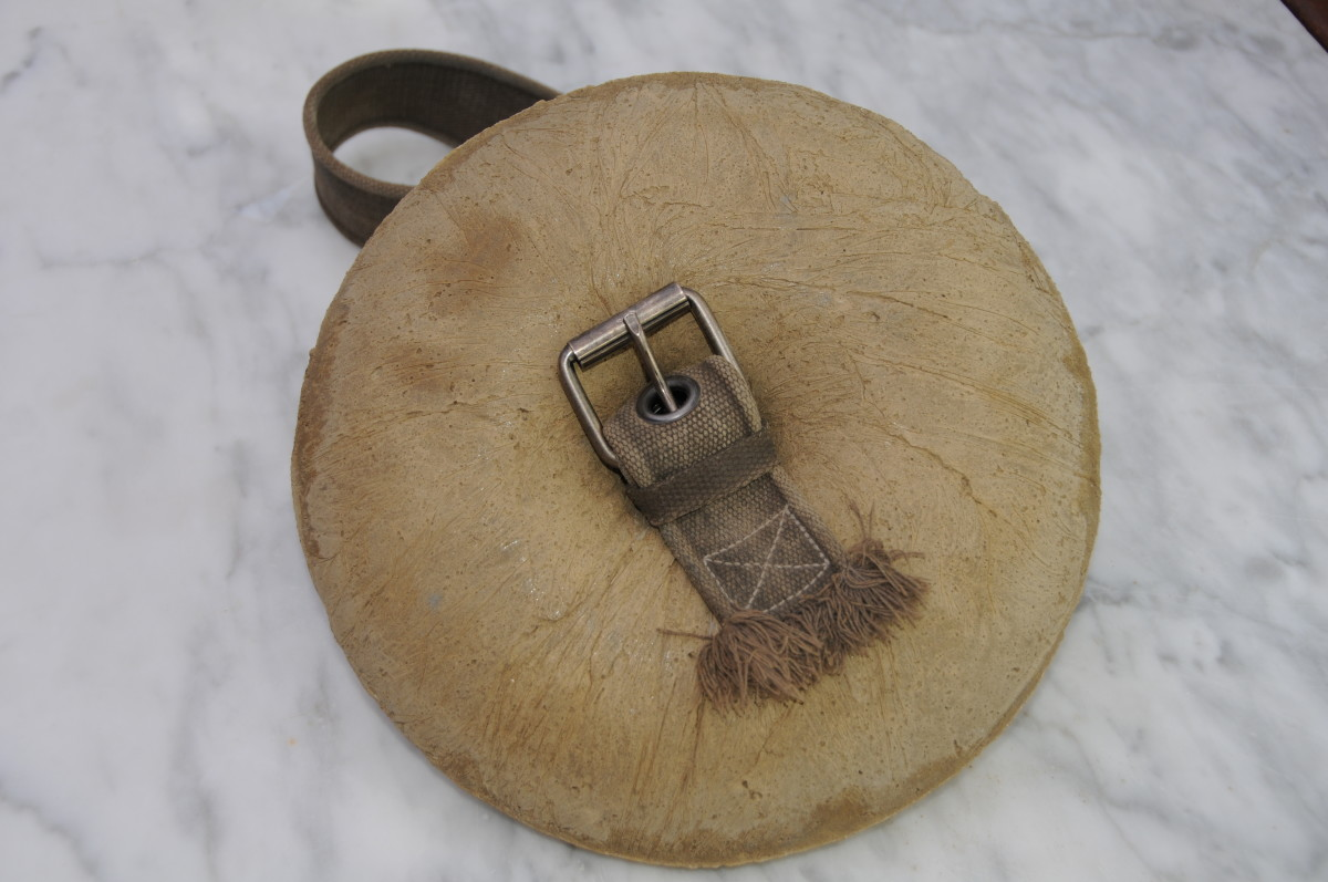 Close detail of the buckle when it is fastened to the feeder