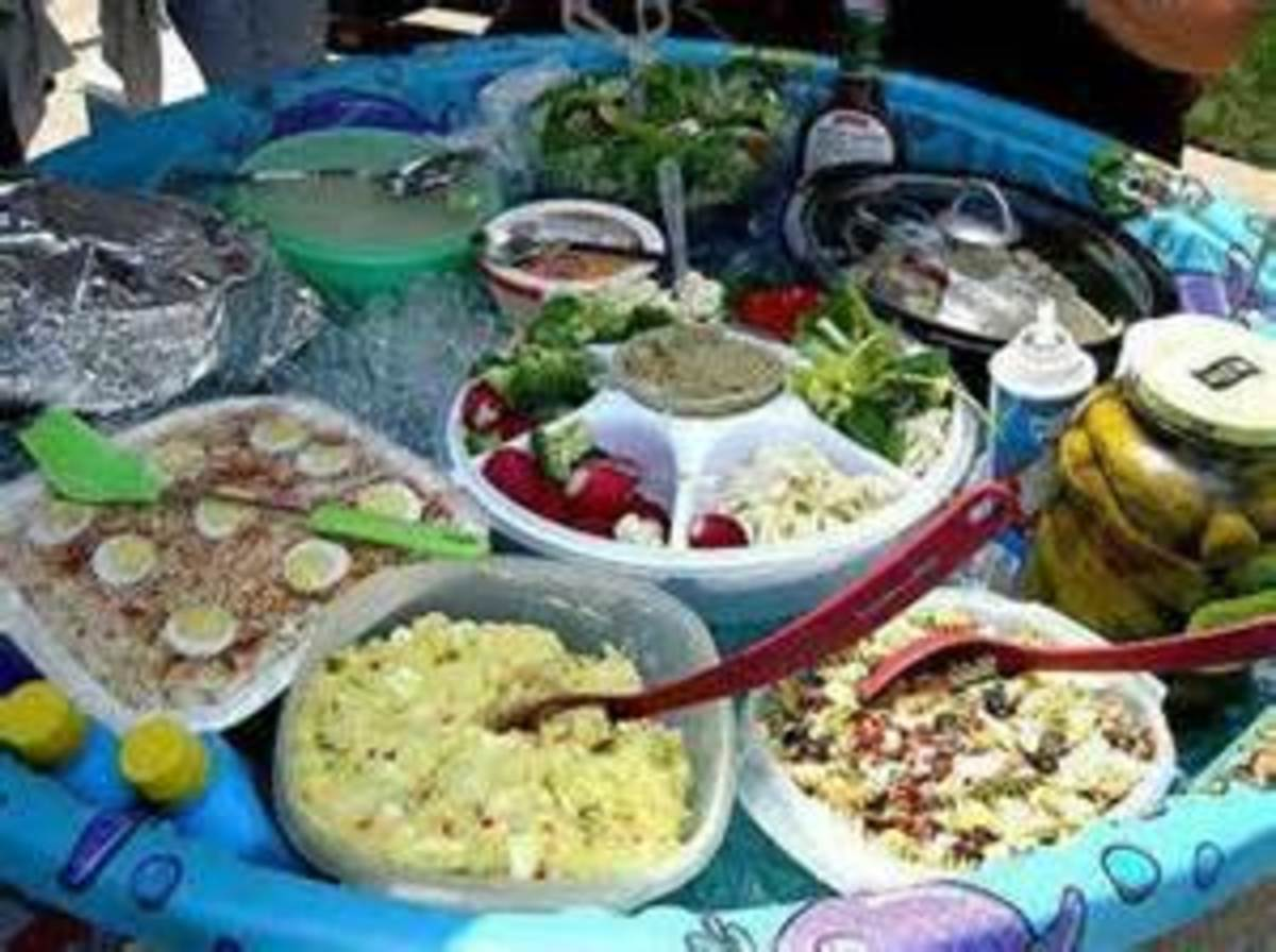 Unique picnic salad bar.  Blow up children's pool on a round table.
