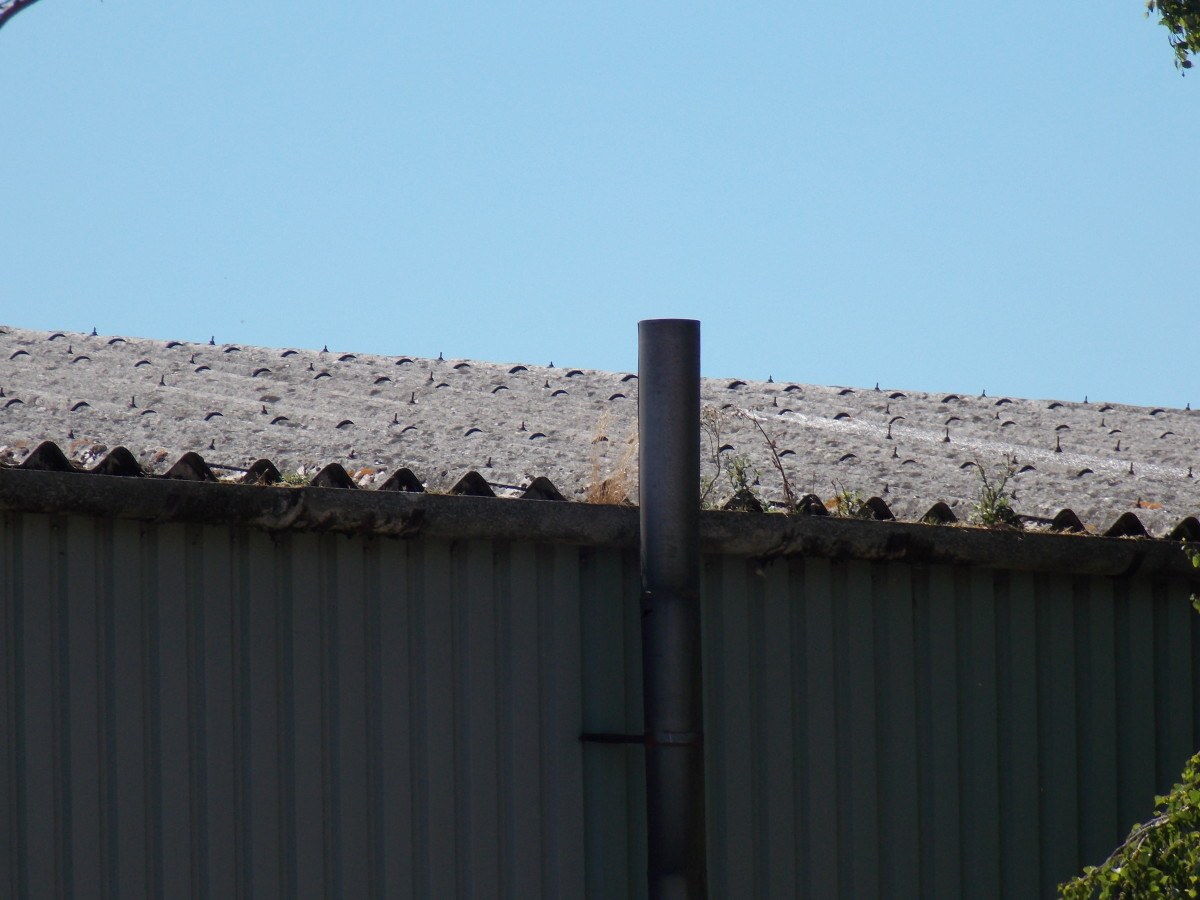 Another example of asbestos corrugated roof sheets, made from asbestos cement.