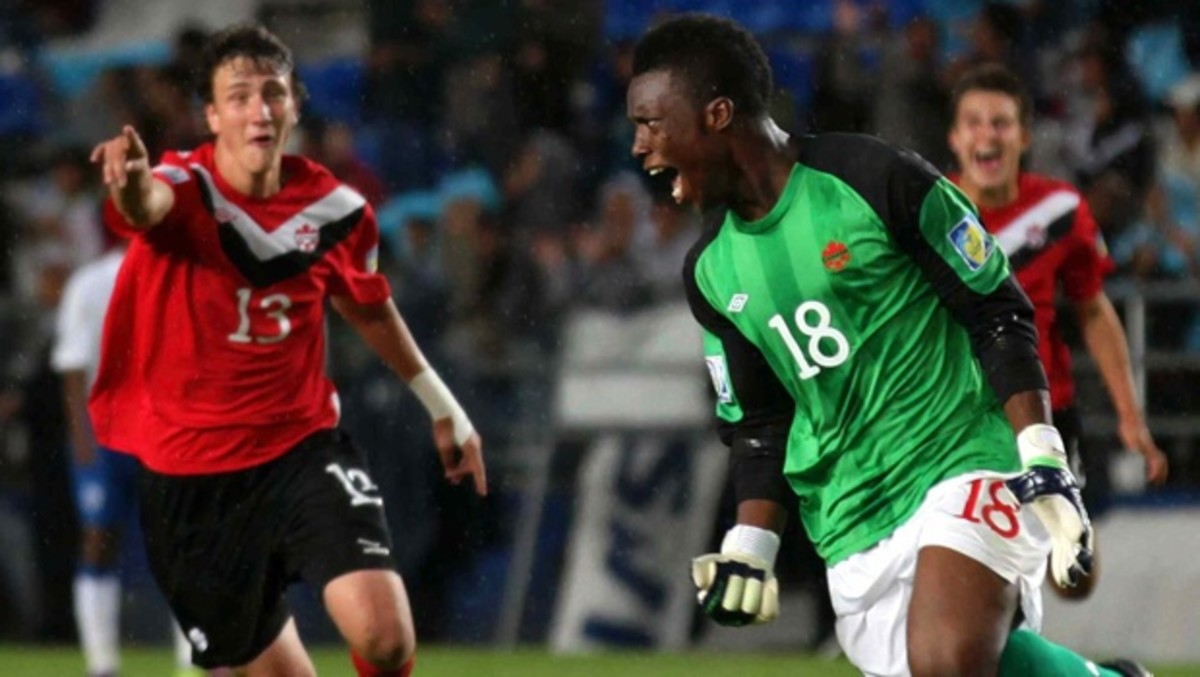 Luca Gasparotto (13) and Qullian Roberts (18) celebrate during a match for Canada in the 2011 FIFA U-17 World Cup. Roberts became the first goalkeeper ever to score in any FIFA 11-a-side competition.