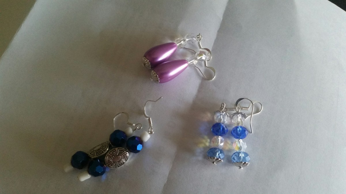 If you notice, the pair of blue earrings were made from the blue beads that were in the blue anklet that I made up above. I had a pair of each left, so I used them in this project. I had another pair of the pinkish beads, so  I made my mother a pair.