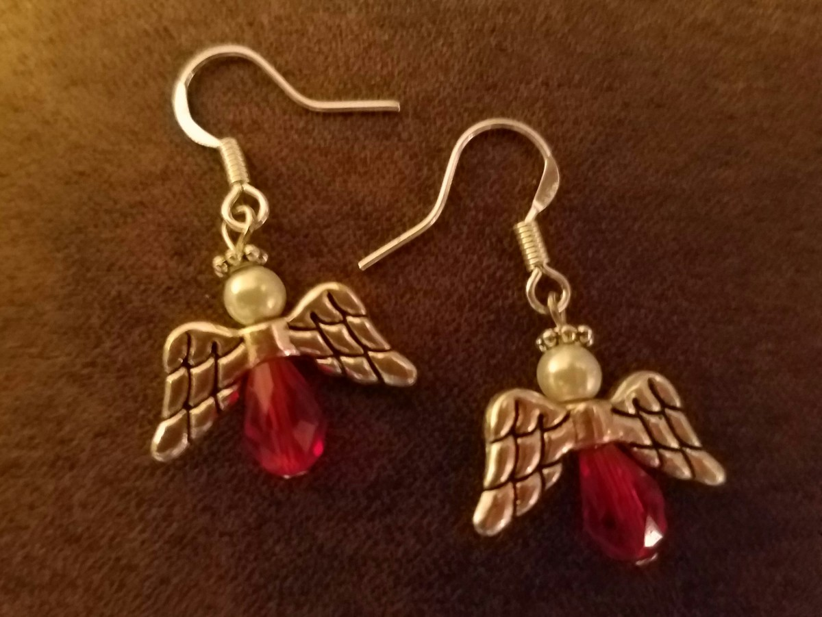 I made two pairs of these earrings. Planning to make one more pair. Need more hooks. I gave my mom her earrings early so she can wear them to church. The other two pair are for my sisters in law.