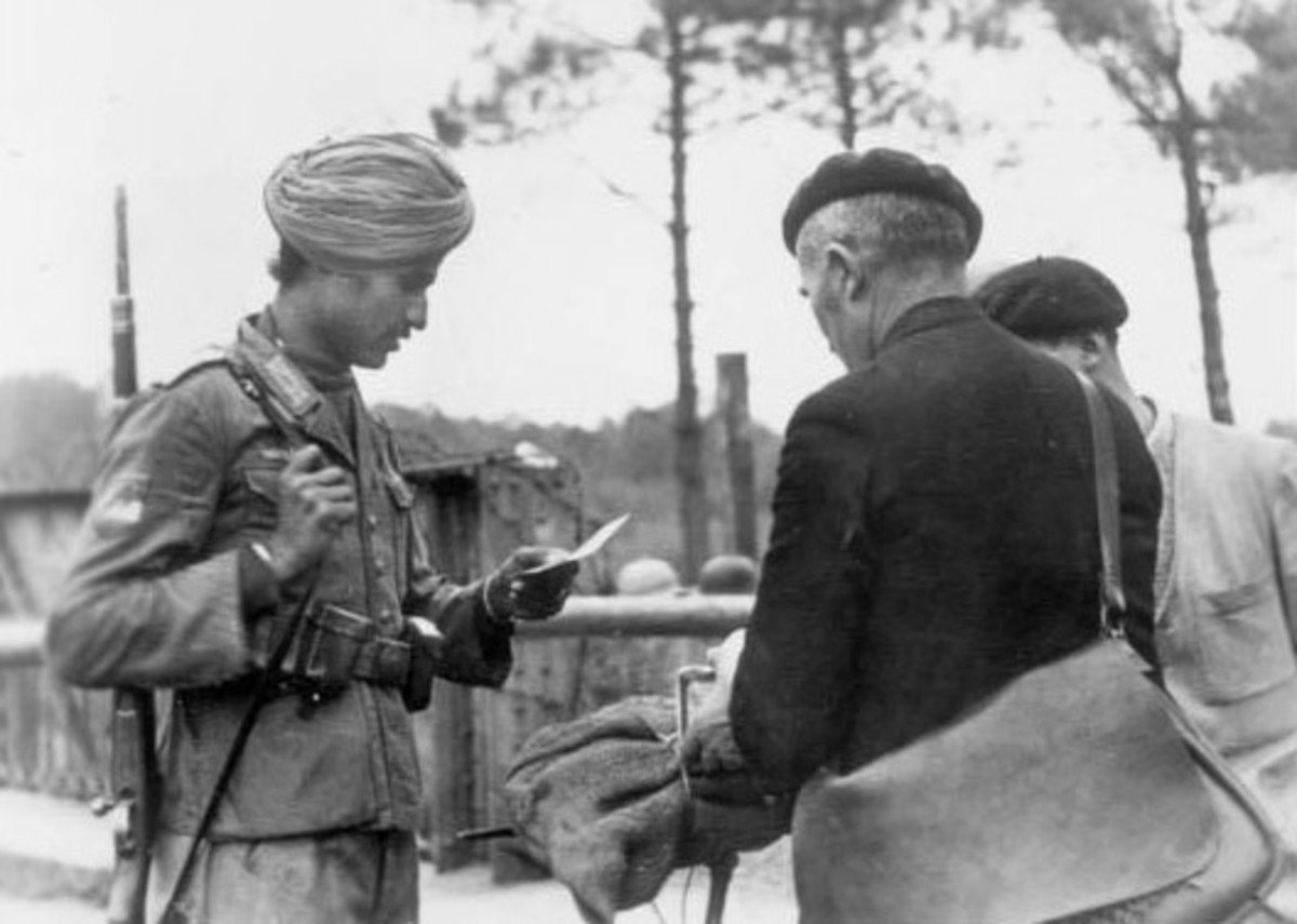 Indian soldier checking papers in France