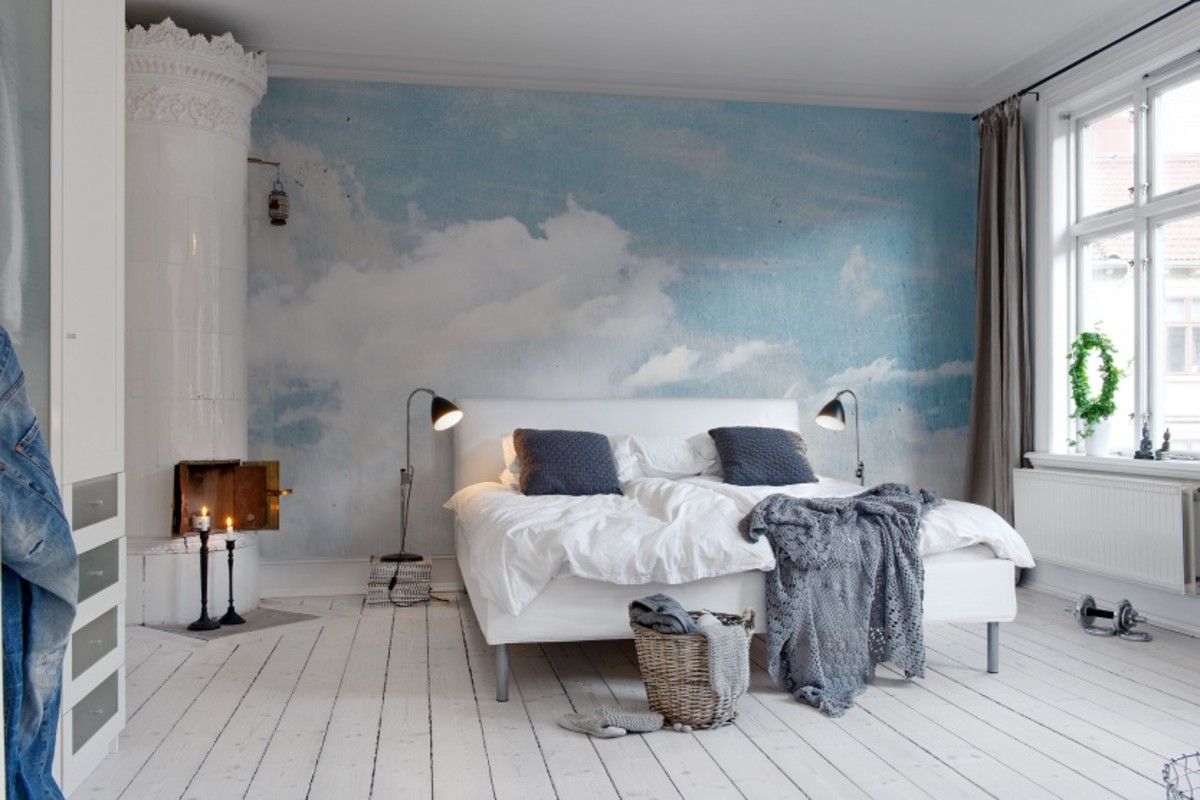 This large cloud wall mural fills the bedroom without overwhelming the eye.
