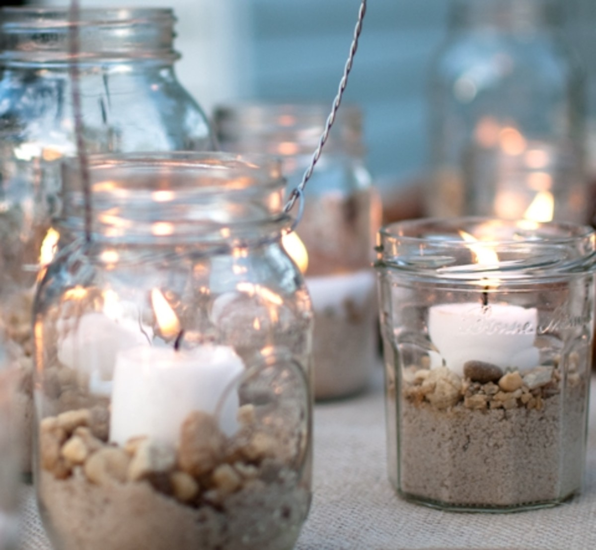 You can arrange candles in mason jars on a flat surface or hang them in your bedroom.