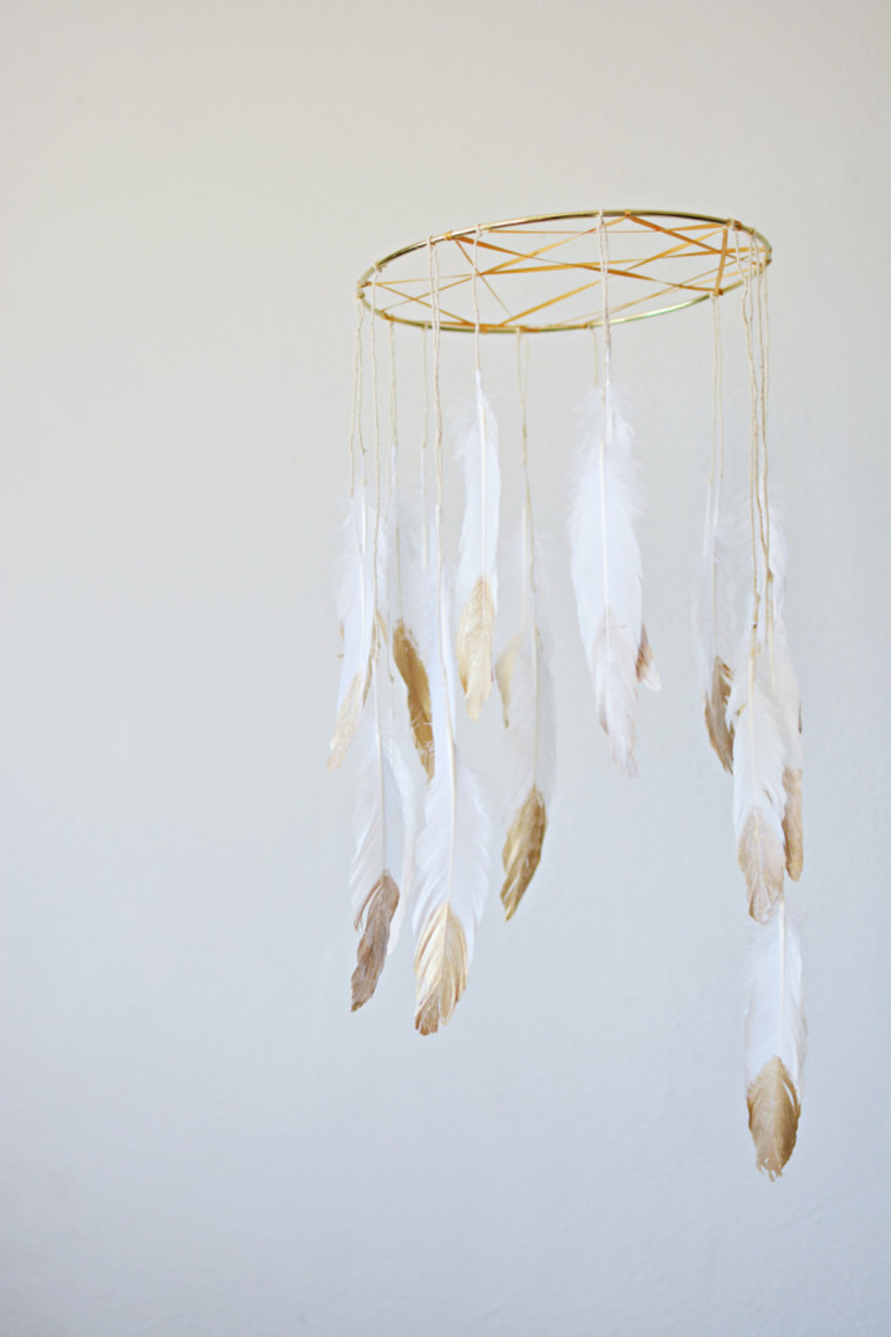 DIY dream catcher mobile - http://blog.landofnod.com/honest-to-nod/2014/09/dream-catcher.html [link no longer active]