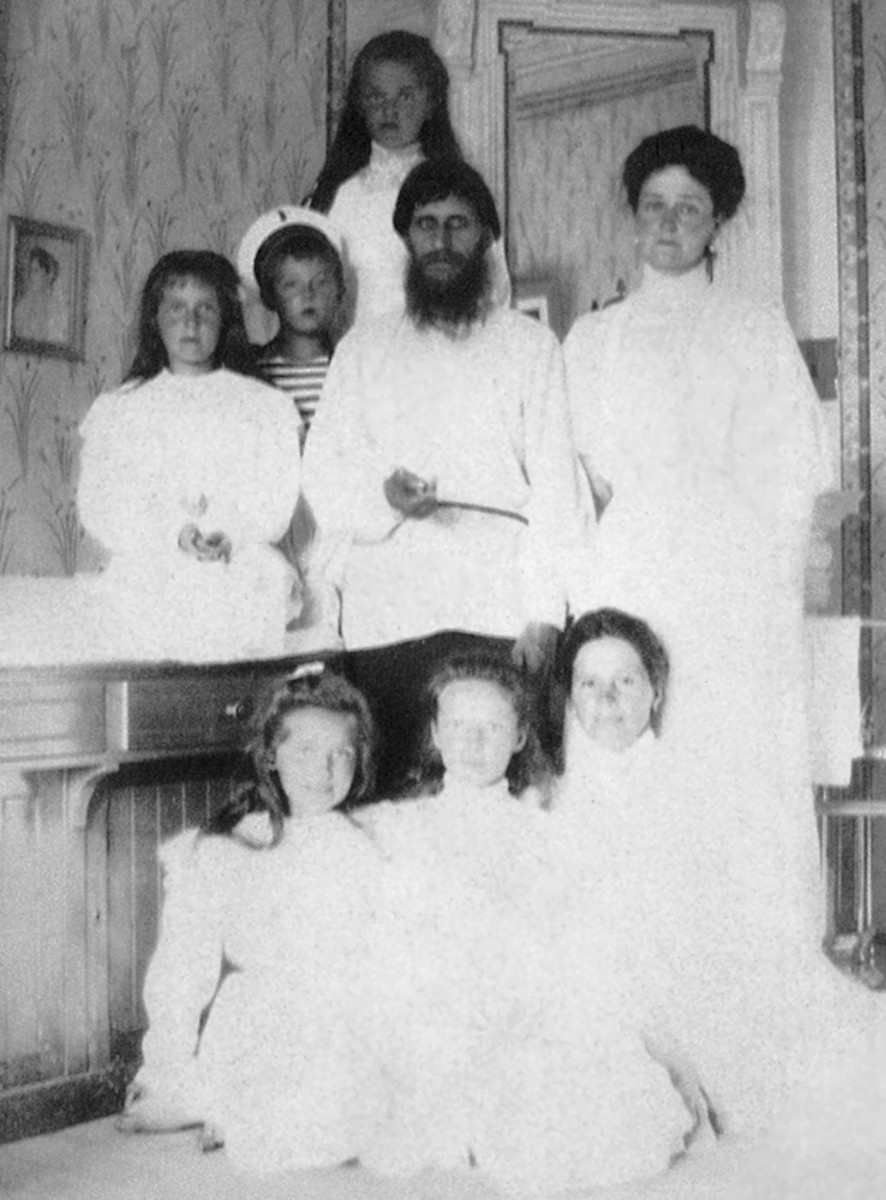 Rasputin with Alexandra and all of her children, Alexie is to the left of Rasputin.