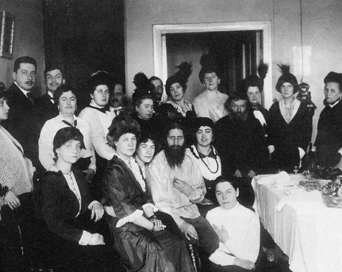 Rasputin surrounded by his family and friends his father is the man on his right. Note the telephone on the wall in the background.