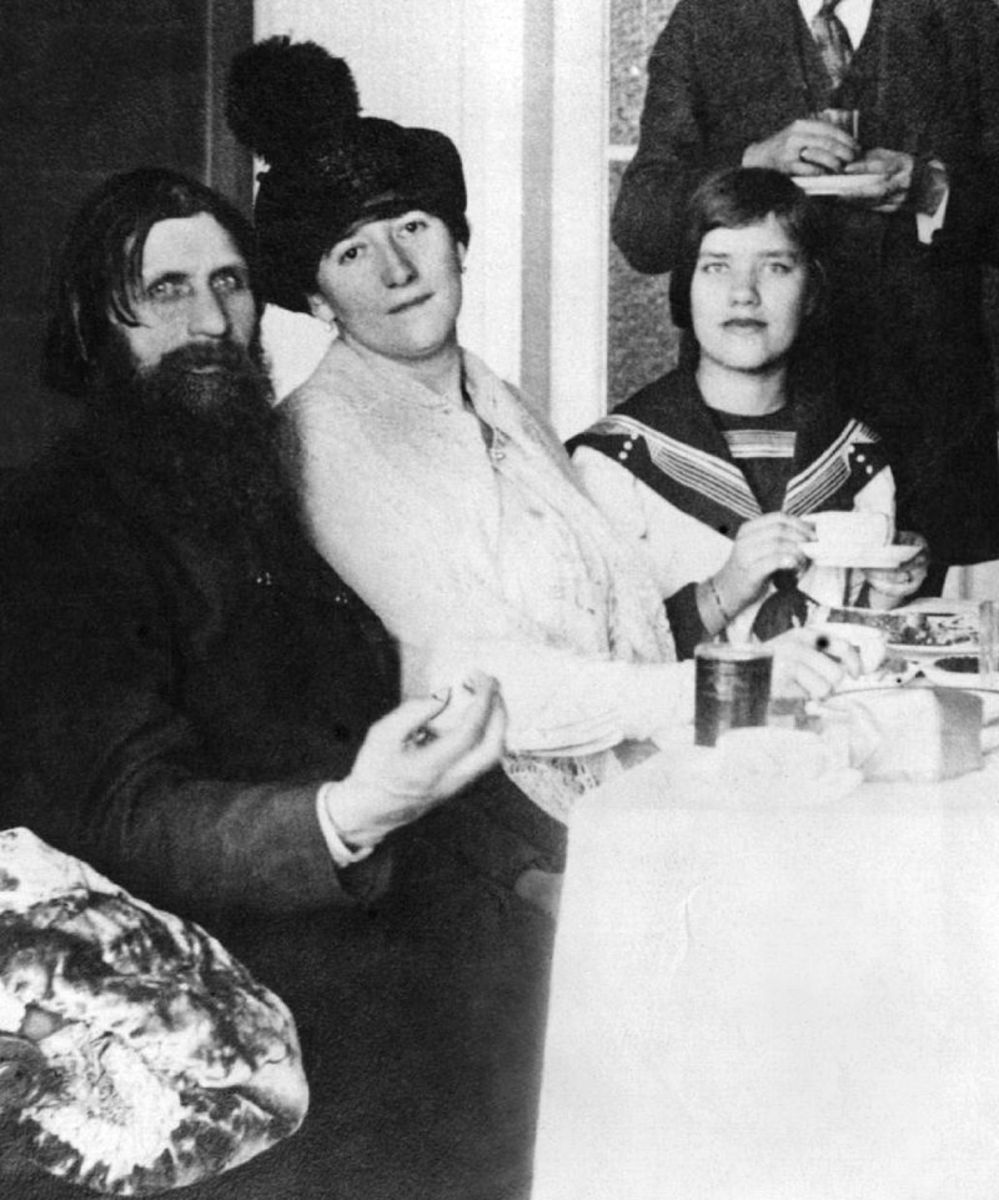 Rasputin with his Daughter Maria on the far right.