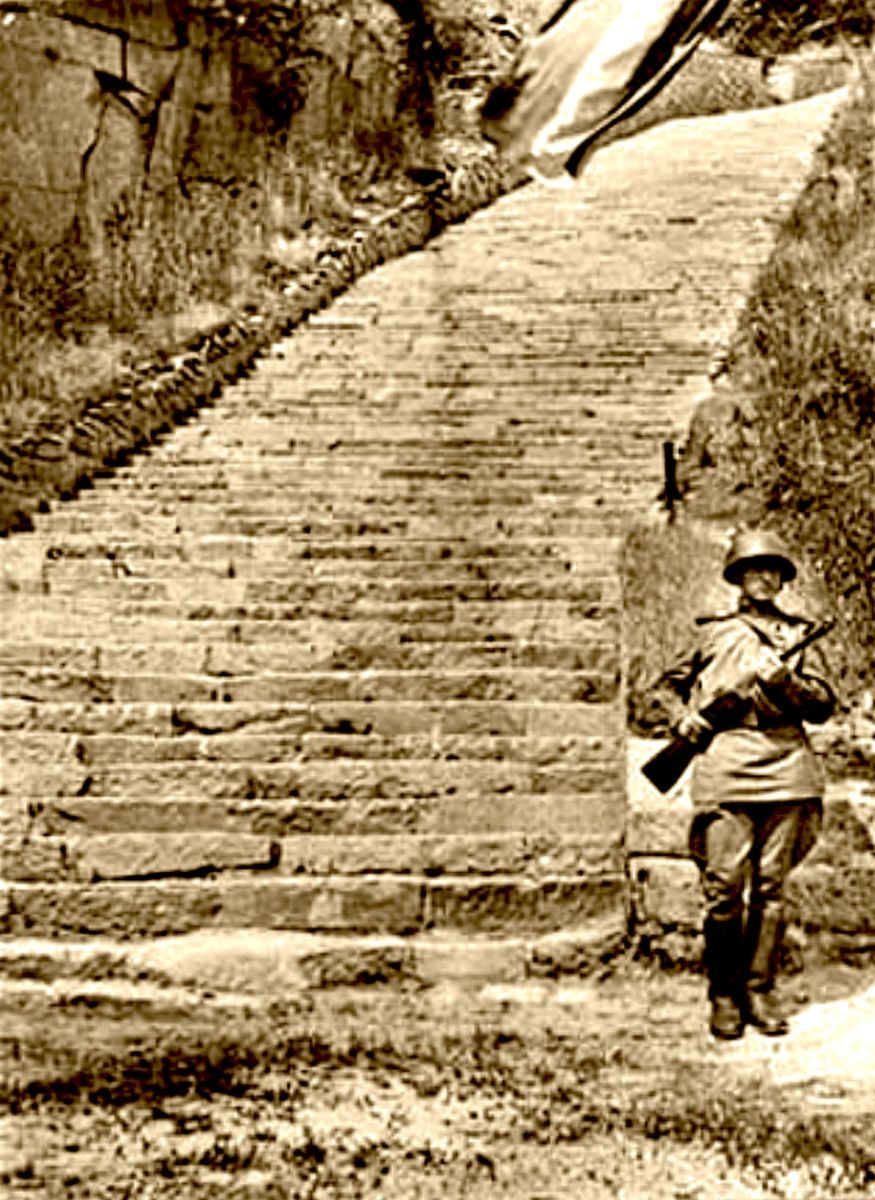 "The photo above is one of hundreds in Bernadac voluminous works shows the ""Stairway of Death"" at the Mauthausen camp. In the photo a Soviet soldier is standing as a guard after the camp was made into a Holocaust Memorial Site by the Soviet Union gove"