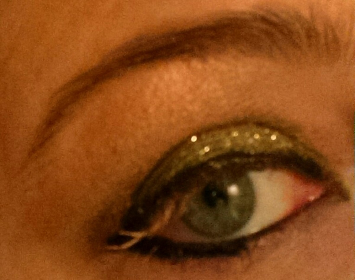 Desert Dazzle shadow over eyelid with Burnished Bling used as mascara.  Peach Prism on brow bone, and Desert Dazzle glitter over eyelid