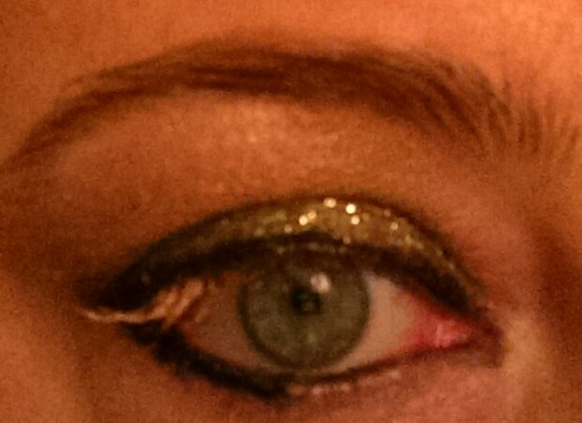 Desert Dazzle shadow over eyelid, Burnished Bling used as mascara, Peach Prism on brow bone, and Desert Dazzle glitter over eyelid