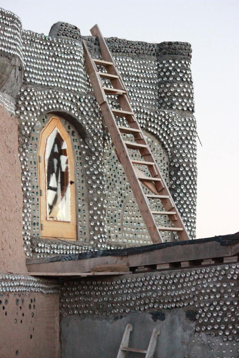 Earthship of Taos, New Mexico.  Aluminum cans replace bricks in this Earthship.