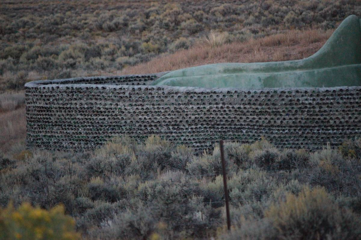 Earthship near Taos, New Mexico.   Closer view of bottle fence.