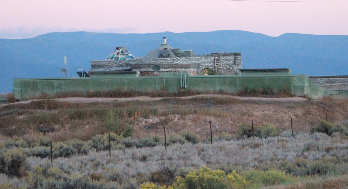 Earthship near Taos, New Mexico.  Each Earthships complements the surrounding terrain.