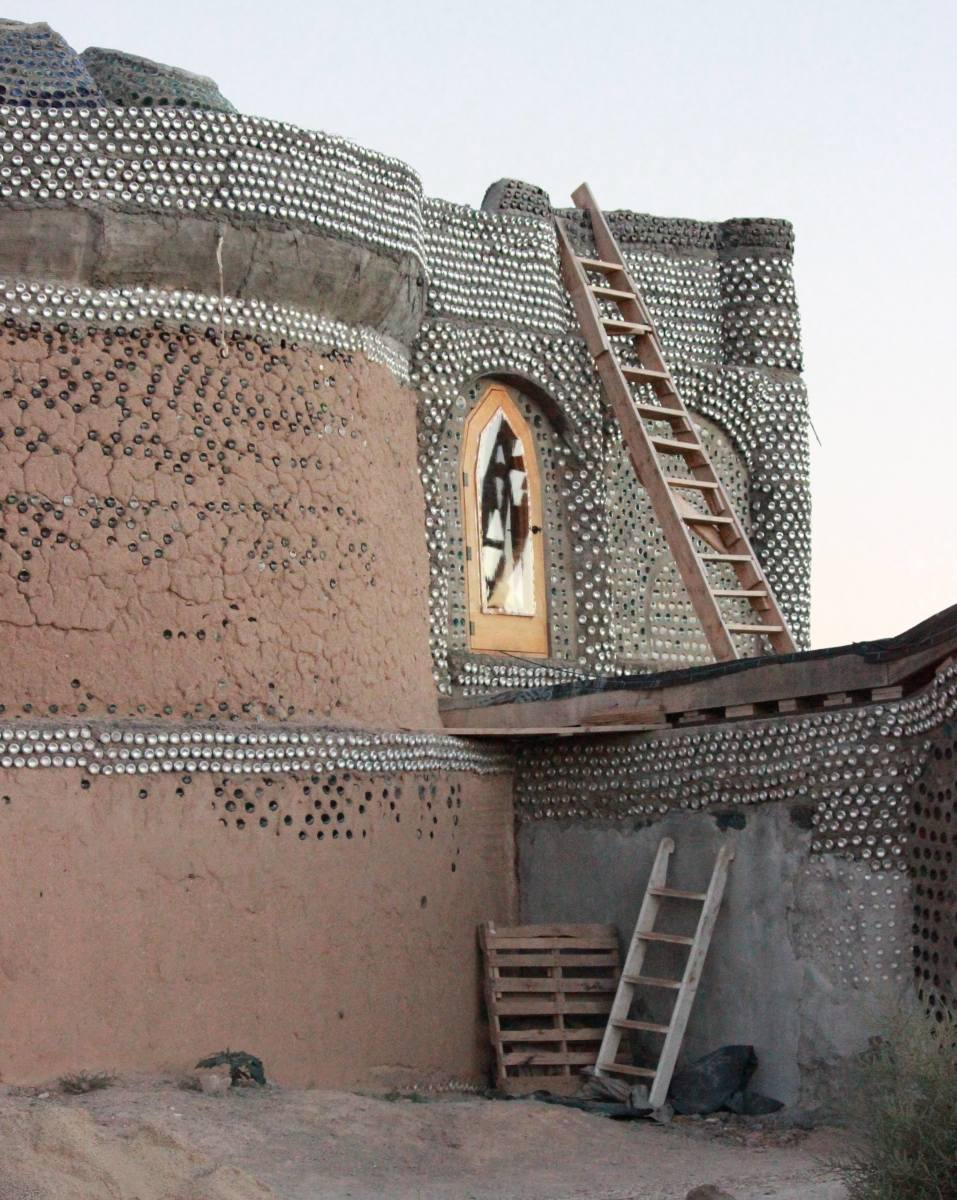 Earthship of Taos, New Mexico.  It is possible to add additional stories to an Earthship when you know what you're doing.