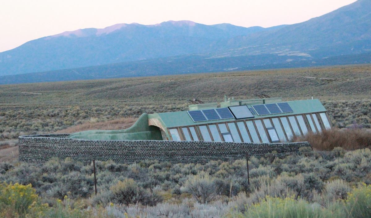 Earthship near Taos, New Mexico.  Note the greenhouse that spans one whole side of the ship; the inhabitants are meant to grow their own food.